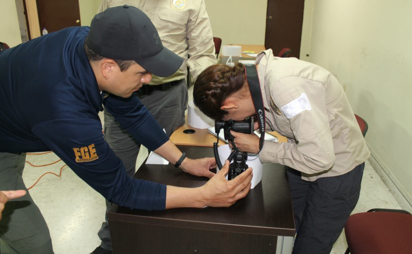 Forensic training image courtesy of USDOJ/ICITAP