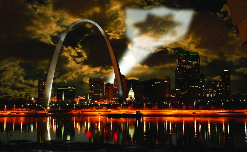 Night shot of St. Louis projecting badge symbol as a call for help